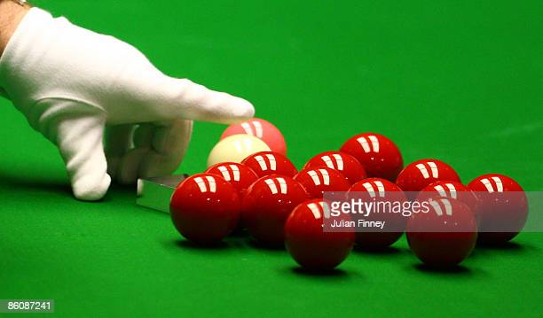 A detail shot of the referee replacing the white ball in the match between Liang Wenbo of China and Ding Junhai of China in the Betfred World Snooker...