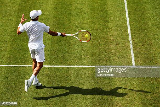 Detail shot of the shadow as Jan Hernych of Czech Republic plays a forehand shot during his Gentlemen's Singles second round match against Roberto...