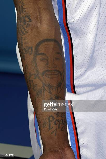 A detail shot of the tattoos of Dajuan Wagner of the Cleveland Cavaliers during Media Day on September 30 2002 at Gund Arena in Cleveland Ohio NOTE...