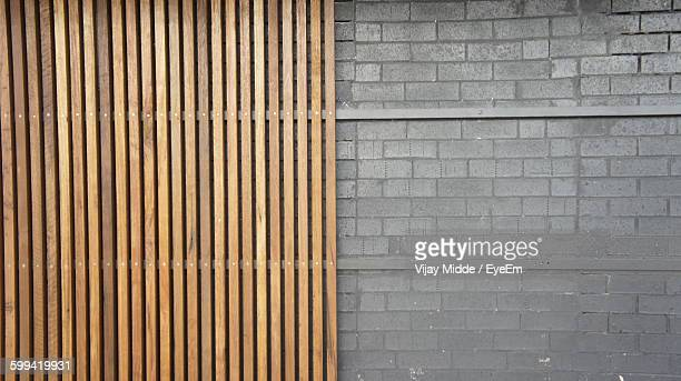 Detail Shot Of Wooden And Stone Wall
