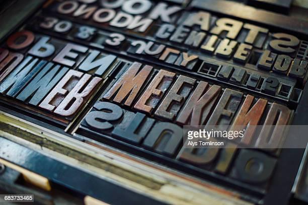 Detail shot of wooden letterpress letters in print workshop