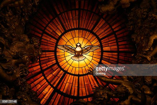 A detail showing the Holy Spirit from Cathedra Petri by Gian Lorenzo Bernini in St Peter's Basilica | Located in St Peter's Basilica