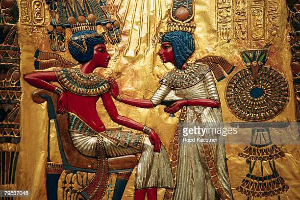 detail showing tutankhamen and queen from decorated throne of tutankhamen - egyptian culture stock photos and pictures