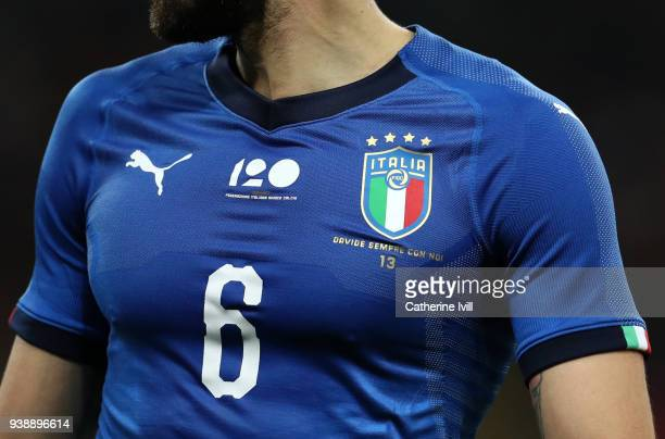 Detail under the Italy crest on a shirt with the words Davide Sempre Con Noi meaning You are always with us in memory of the Davide Astori during the...
