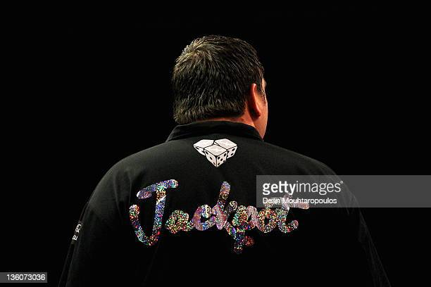 A detail veiw of the shirt with the word 'Jackpot' worn by Adrian Lewis of England as he gets his darts ready to throw in his match against Robert...