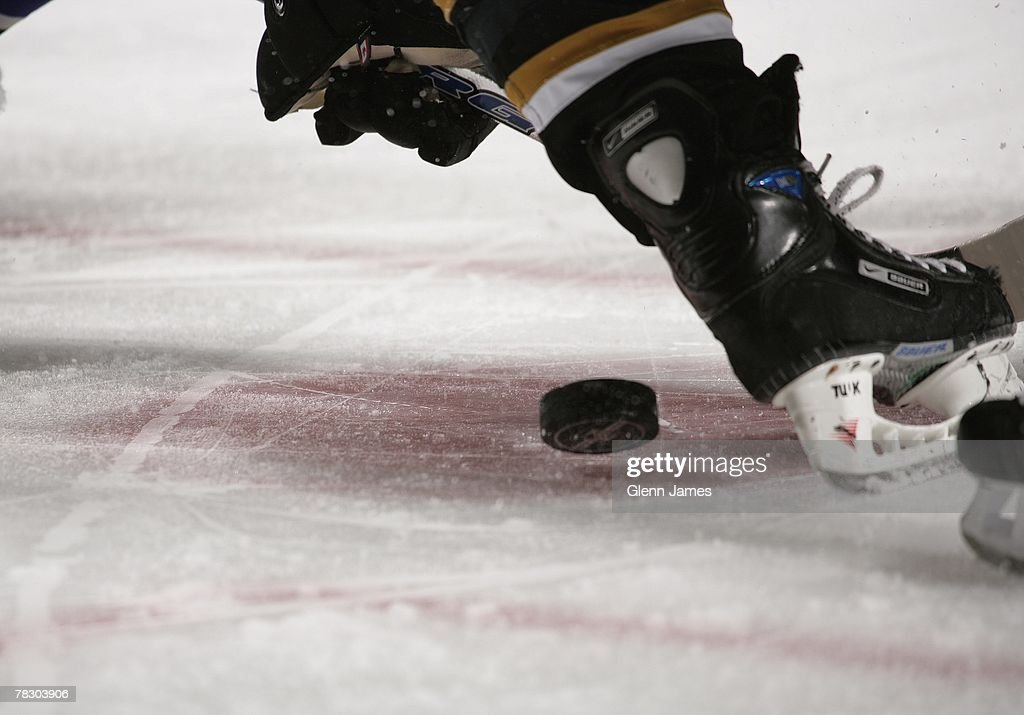 Detail view as a puck is dropped in the face-off circle of the Dallas Stars against the Los Angeles Kings at the American Airlines Center on October 10, 2007 in Dallas, Texas .