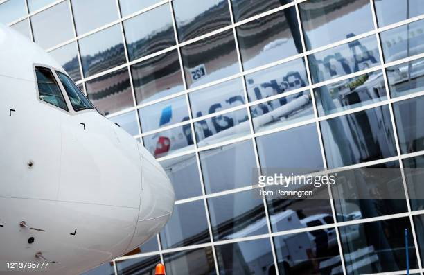 A detail view as American Airlines fleet services employees prepare to load cargo pallets on a 777300 at Dallas/Fort Worth International Airport...