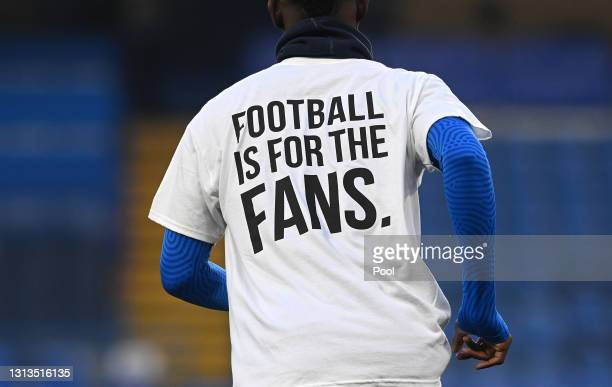Detail view as Brighton & Hove Albion players warm up wearing a t-shirt with a message in protest against the European Super League prior to the...