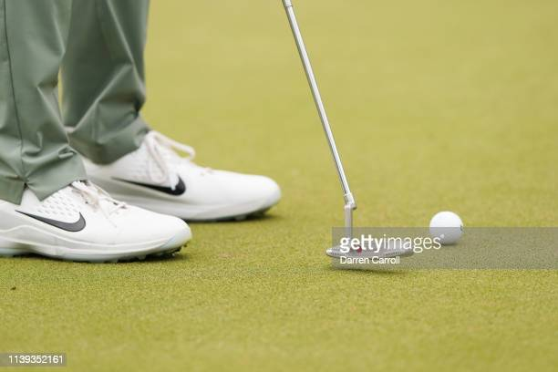 Detail view as Tiger Woods of the United States putts during the quarterfinal round of the World Golf Championships-Dell Technologies Match Play at...