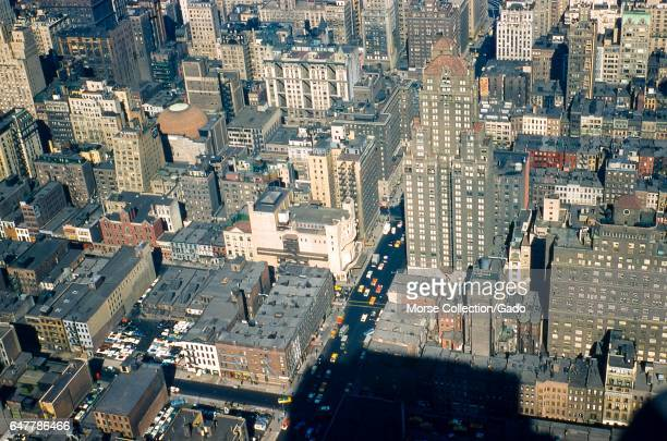 Detail view facing northwest of Sixth Avenue between 53rd and 57th Streets in midtown Manhattan New York City 1957 At center sits the original...