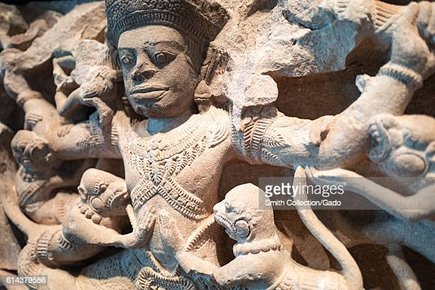 Detail view from the Indian carved stone work Kumbhakarna Battles the Monkeys showing a scene from the epic Ramayana in which Kumbhakarna defeats an...
