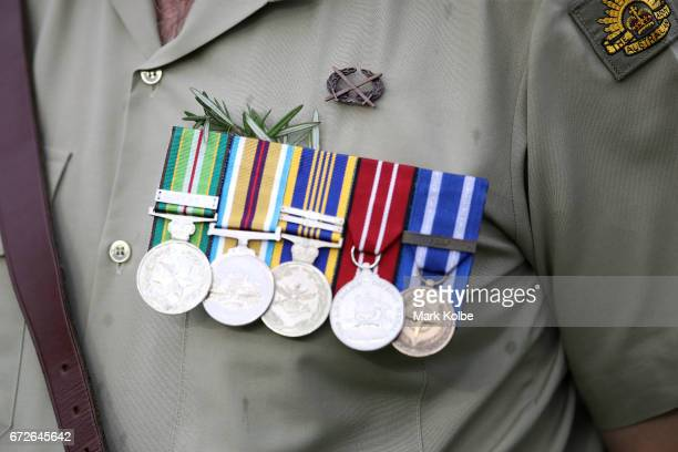 A detail view is seen of Defence force members during the Anzac Day commemoration ceremony before the round eight NRL match between the Sydney...
