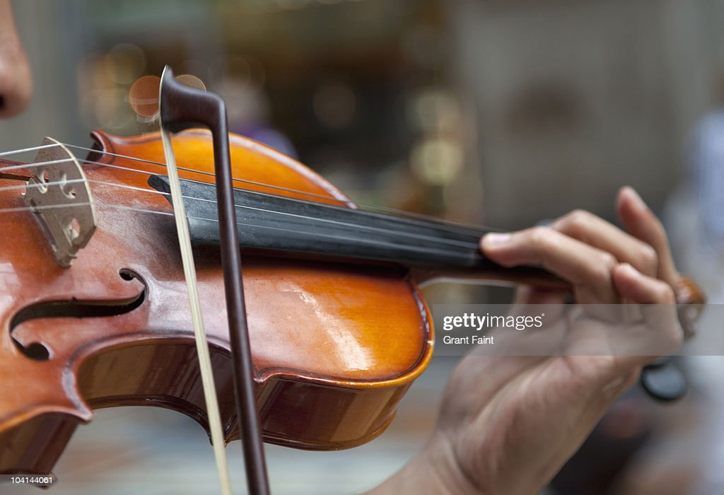 detail view man playing violin in public : Stock Photo