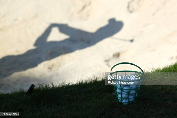 Detail View of a bucket of balls and a golfer's shadow during the second round of the Turkish Airlines Open at the Regnum Carya Golf Spa Resort on...