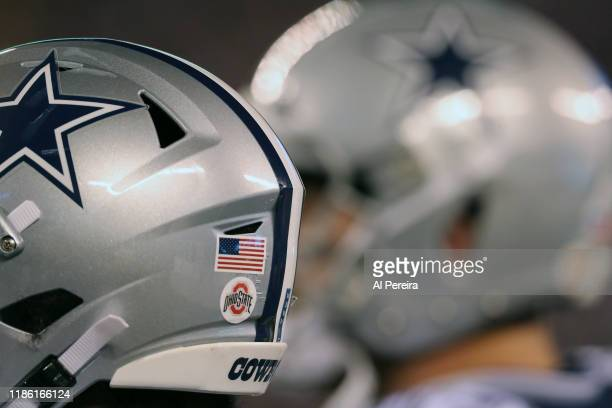 Detail view of a College Football logo sticker on the helmet of the Dallas Cowboys in the game against the New York Giants in the first half at...