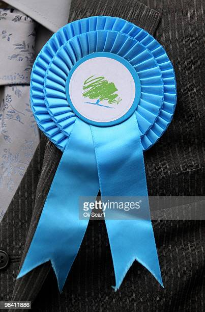 Detail view of a Conservative party rosette worn by a supporter in Loughborough's Market Place on April 12, 2010 in Loughborough, England. Mr Cameron...