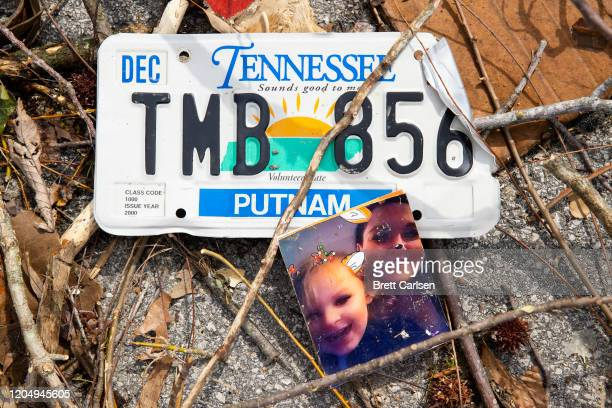 Detail view of a family photograph and license plate in debris near an apartment complex on March 3 2020 in Cookeville Tennessee A tornado passed...