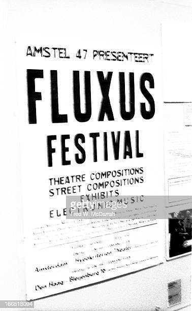Detail view of a Fluxus exhibit that features a poster that advertises an earlier event New York New York March 1 1983