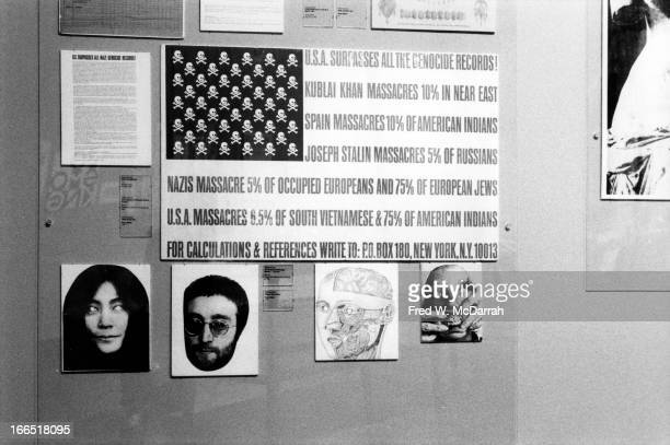 Detail view of a Fluxus exhibit that features a work 'US Surpasses All Genocide Records' that significantly alters the US flag New York New York...