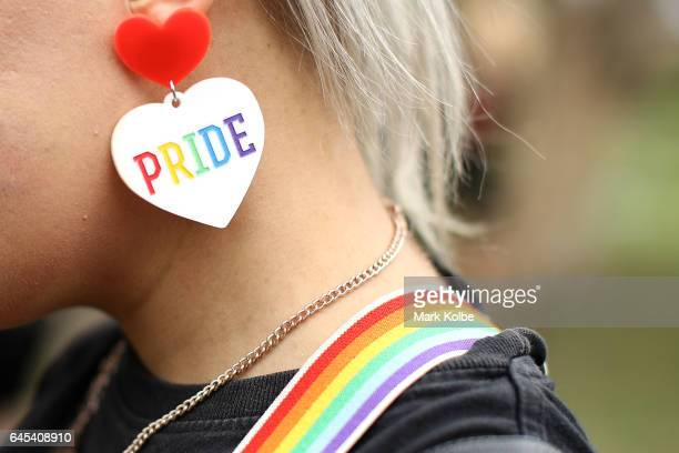 A detail view of a gay pride earring is seen as a runner prepares to take part in the annual Little Black Dress run at Centennial Park on February 26...