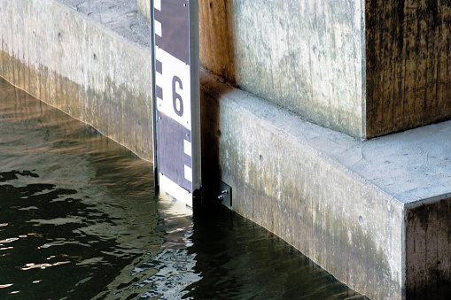 Detail view of a level for water level measurement at the Alster in Hamburg 972683426