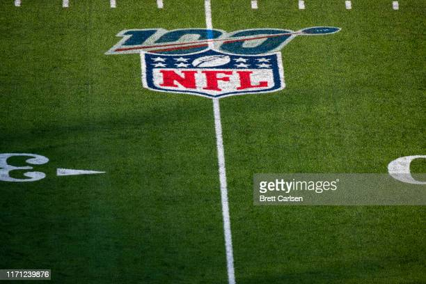 Detail view of a NFL 100 logo on the playing surface at New Era Field before a preseason game between the Buffalo Bills and the Minnesota Vikings on...