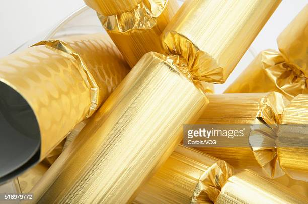 Detail view of a pile of gold Christmas crackers