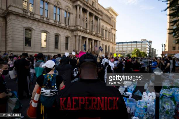 Detail view of a protesters Colin Kaepernick jersey as he and others gather outside city hall on May 29, 2020 in Louisville, Kentucky. Protests have...