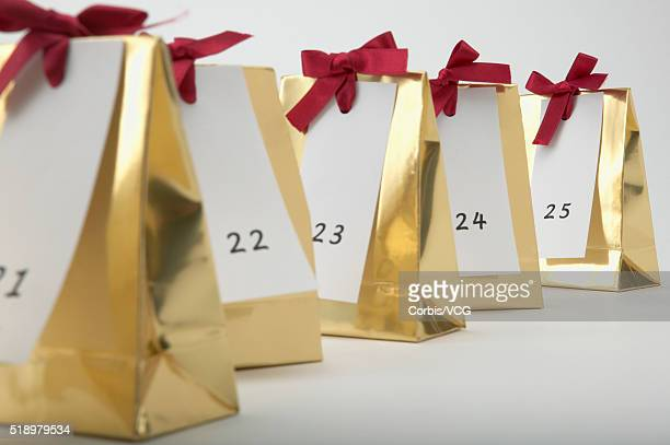 Detail view of a row of Christmas presents labeled with the numbers 21 to 25