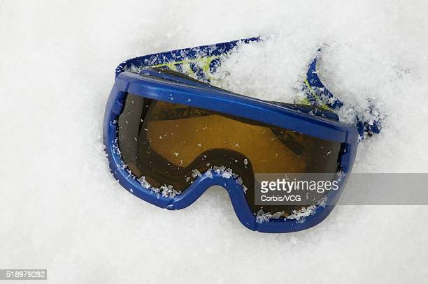 Detail view of a ski goggles in the snow