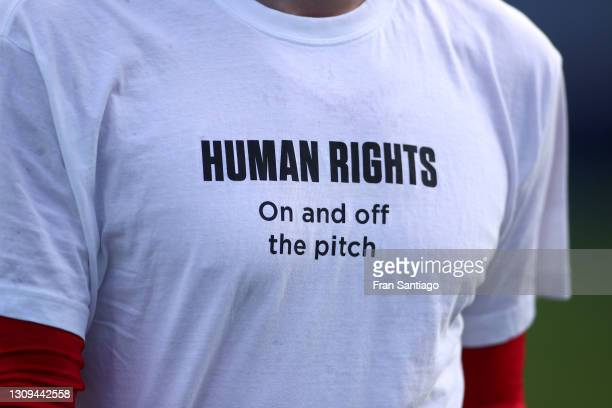 Detail view of a t-shirt worn by Norway players during the warm up with a message about human rights prior to the FIFA World Cup 2022 Qatar...