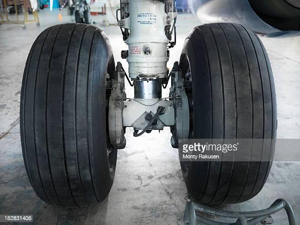 Detail view of airplane wheels in hangar