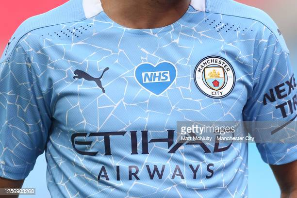 Detail view of an NHS logo displayed on a Manchester City shirt during the FA Cup Semi Final match between Arsenal and Manchester City at Wembley...