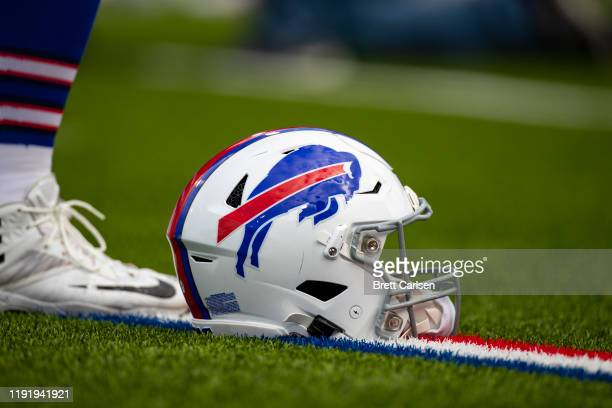 Detail view of Buffalo Bills football helmet on the field during player warmups before the game against the New England Patriots at New Era Field on...