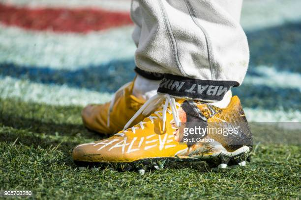 Detail view of custom cleats worn by a Pittsburgh Steelers player featuring a painting of the injured Ryan Shazier before the AFC Divisional Playoff...