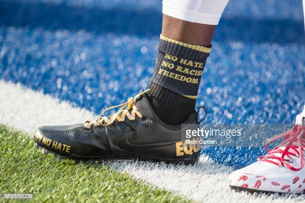 Detail view of custom cleats worn by Devin McCourty of the New England Patriots before the game against the Buffalo Bills at New Era Field on...