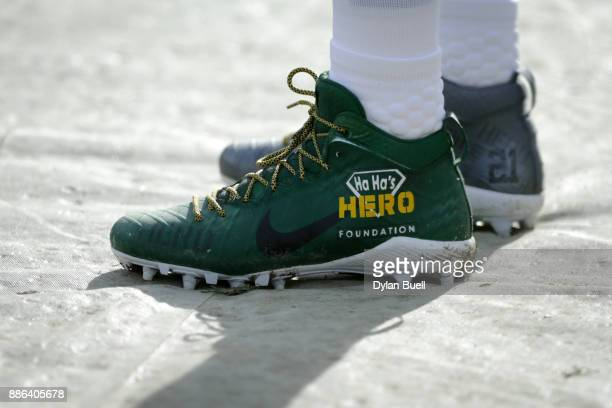 A detail view of custom cleats worn by Ha Ha ClintonDix of the Green Bay Packers before the game against the Tampa Bay Buccaneers at Lambeau Field on...
