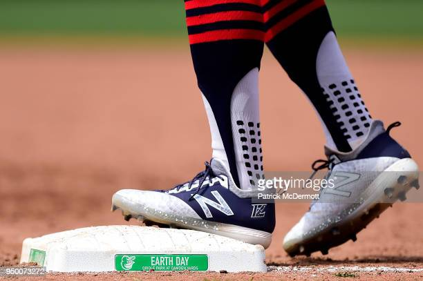 A detail view of Francisco Lindor of the Cleveland Indians baseball cleats as he stands on first base in the sixth inning against the Baltimore...