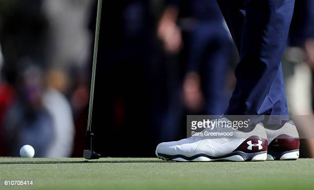Detail view of Jordan Spieth of the United States' Under Armour shoes as he putts during practice prior to the 2016 Ryder Cup at Hazeltine National...