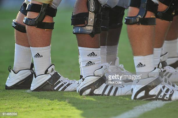 Detail view of knee braces and cleats of the Central Florida Knights linemen during the game against the Memphis Tigers at Bright House Networks...