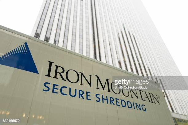 Detail view of logo on the side of an Iron Mountain paper shredding and document destruction truck parked in Manhattan New York City New York...