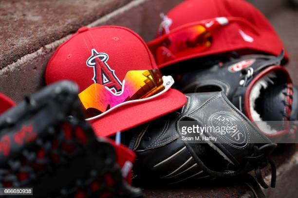 A detail view of Los Angeles Angels of Anaheim hats and gloves during a game against the Seattle Mariners at Angel Stadium of Anaheim on April 9 2017...