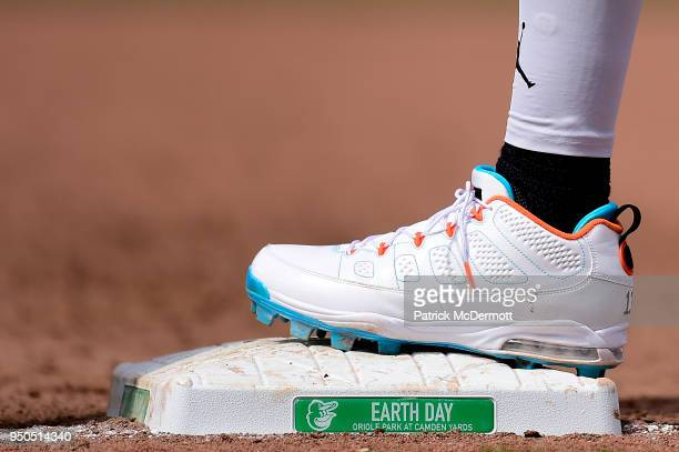 A detail view of Manny Machado of the Baltimore Orioles baseball cleats as he stands on first base in the sixth inning against the Cleveland Indians...