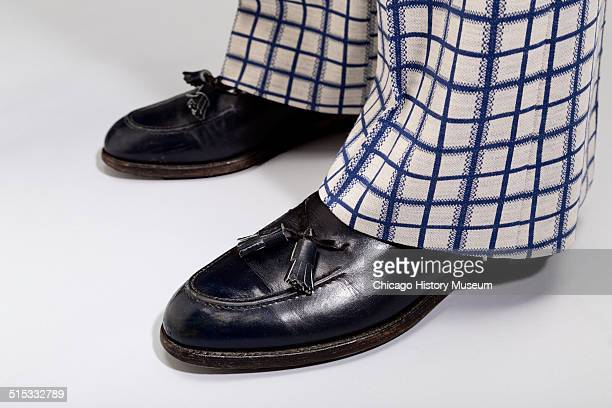 Detail view of man's plaid polyster twopiece suit designed by Lawrence Pucci shown with black shoes 1974 Shown as part of the Chicago History...