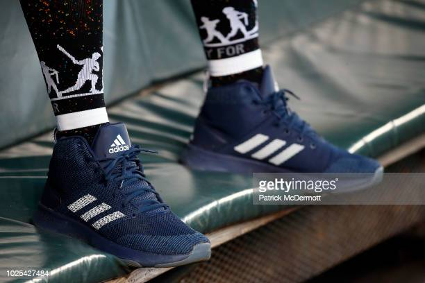 A detail view of Masahiro Tanaka of the New York Yankees Adidas cleats as he sits in the dugout before a game against the Baltimore Orioles at Oriole...