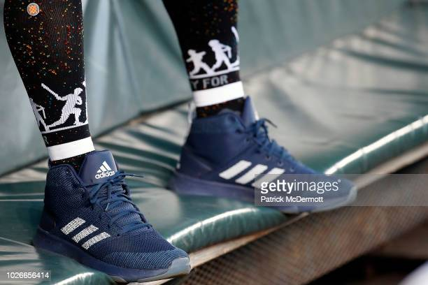 A detail view of Masahiro Tanaka of the New York Yankees Adidas baseball cleats as he sits in the dugout before a game against the Baltimore Orioles...