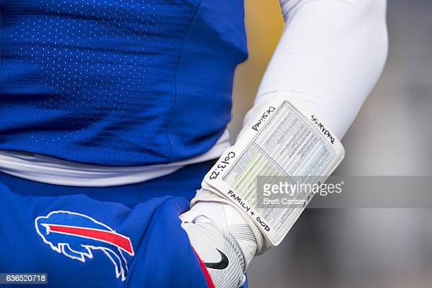 Detail view of messages written on the wrist coach of Tyrod Taylor of the Buffalo Bills before the game against the Cleveland Browns on December 18...