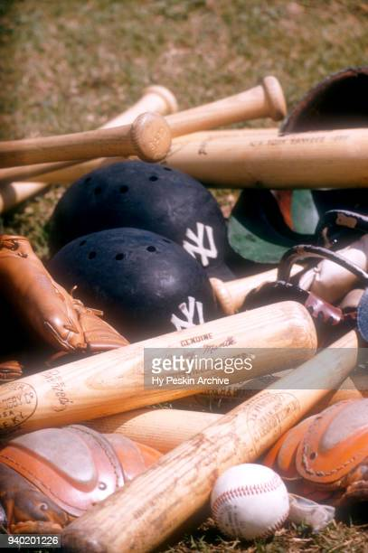Detail view of Mickey Mantle's Louisville Slugger bats and helmets are shown at the Spring Training home of the New York Yankees circa February 1957...