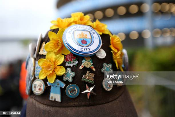 A detail view of pins collected by a fan ahead of the Premier League match between Manchester City and Huddersfield Town at Etihad Stadium on August...