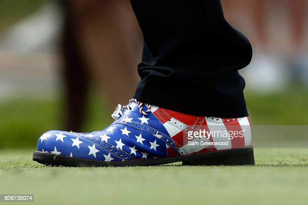 A detail view of Scott Hend of Australia's shoe as he hits off the 17th tee during the third round of the World Golf Championships Bridgestone...